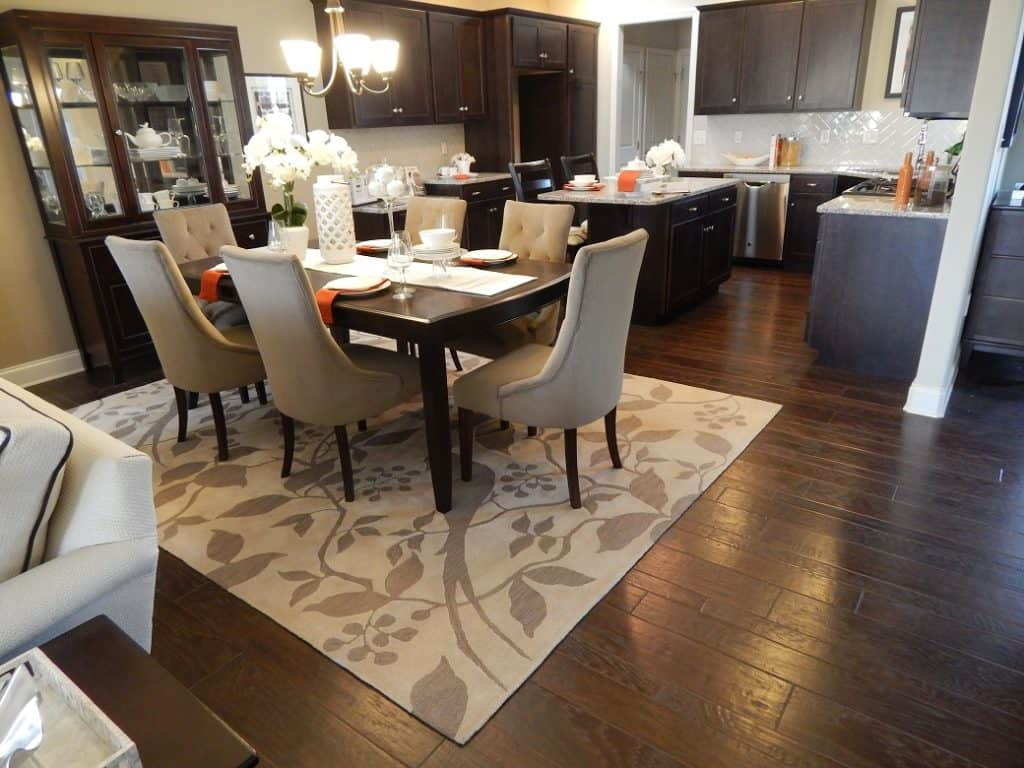 Add style with an area rug martins flooring hardwood floors with area rug dailygadgetfo Choice Image