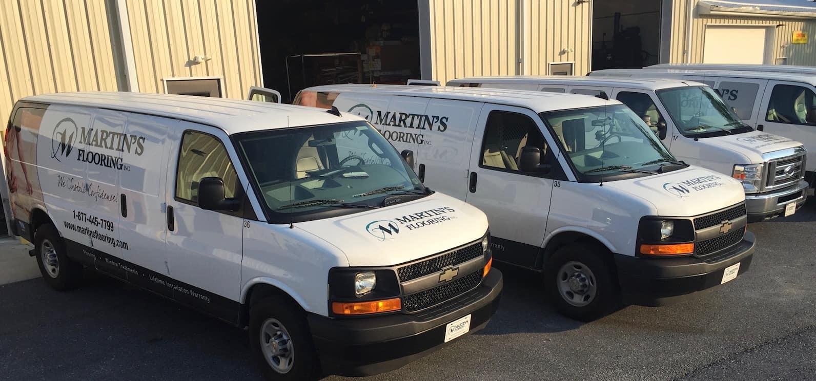 Martin's Flooring fleet of flooring installation trucks